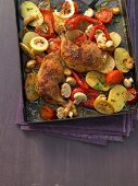 Oven-roasted pepper chicken with potatoes and mushrooms
