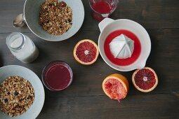 Blood orange juice, muesli and milk