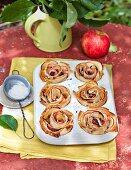 Apple strudel muffins in a muffin tin