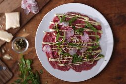 Beef carpaccio with radishes and rocket