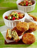 Pepper and cucumber salad with potato cakes
