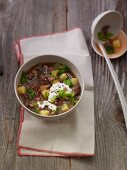 Savoy cabbage stew with minced meat, potatoes and diced bacon