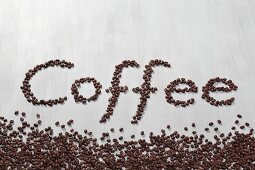 The word coffee written in coffee beans