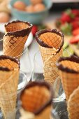 Homemade ice cream cones with chocolate edges in glasses