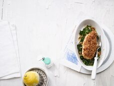 Crispy lemon chicken on a bed of spinach (low carb)