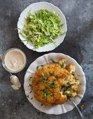 A whole baked cauliflower with a chilli and almond mayonnaise served with cos lettuce salad