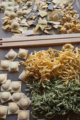 Ravioli, tagliatelle and tortellini on a drying rack
