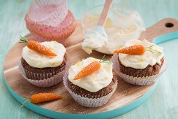 Carrot and pineapple cupcakes with marzipan decorations