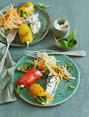 Raw white cabbage salad with stuffed peppers