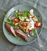 Spicy lamb fillet with bulgur salad and purslane