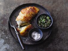 Fish fillet with potato soup and herb sauce
