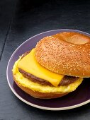 A sesame seed bagel with sausage, egg and cheese for breakfast (USA)