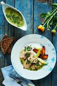 Cooked cod roe with a caper sauce and root vegetables