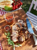 Grilled ribs with a pepper marinade and tomato sauce