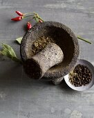 Spices being ground in a stone mortar