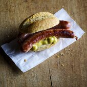 Homemade Thuringia sausages with mustard in a roll