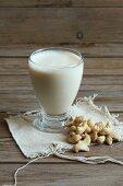 A glass of cashew nut milk with cashew nuts