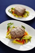 Steamed fillet steak with vegetable strips and horseradish sauce