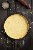 Baked shortcrust pastry in a baking tin pierced with a fork