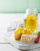Soft cheese with yellow watermelon jam