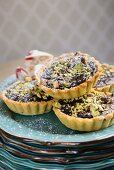 Belgian chocolate tarts with pistachios