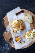 Waffles with poached pears, yoghurt and passion fruit
