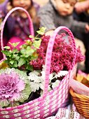 Basket of autumnal flowers as decoration for autumn picnic