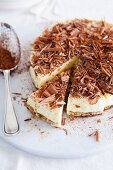 Tiramisu cake with grated chocolate, sliced