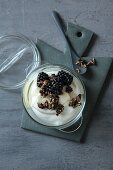 Yoghurt with crunchies and blackberries