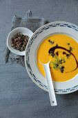 Pumpkin soup with crunchies and pumpkin seed oil