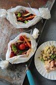 Oven-roasted vegetables with a millet and lentils, and a tomato dip