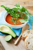 Gazpacho with herbs and avocado served with white bread