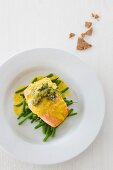 Salmon fillets with black morel mushrooms and curry sauce on green beans