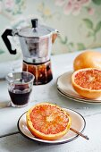 Grapefruit with a caramel crust served with espresso