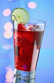 A red cocktail with ice cubes and cocktail cherries