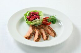 Salmon with a colourful pepper crust and a side salad