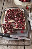 Chocolate tray bake with cherries and crumbles