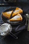 Sweet pumpkin tart with chocolate cream and icing sugar