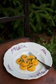 Pumpkin gnocchi with sage butter and grated parmesan cheese
