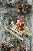 A stack of cinnamon star biscuits on a mini wooden sledge