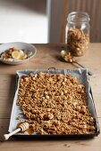 Granola with nuts and honey on a baking tray
