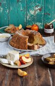 Chiffon cake with olive oil served with cheese, nectarines and honey