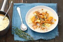 Chanterelle mushroom soup with potatoes, cream and thyme