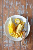 Cooked corn cobs, partially scraped
