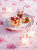 A Christmas dessert platter with a mini ice cream Charlotte, ice cream meringues and chocolate ice cream shake