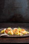 Oriental fennel and pineapple salad with a vanilla dressing and grilled scallops