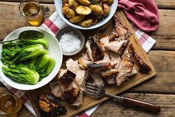 Roasted pork belly with rosemary potatoes, bok choy and beer