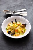 Rosefish and mussels in a saffron curry broth