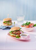 Chicken burgers with red onions, cucumber and tomatoes