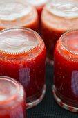Raspberry jam in upside-down jars